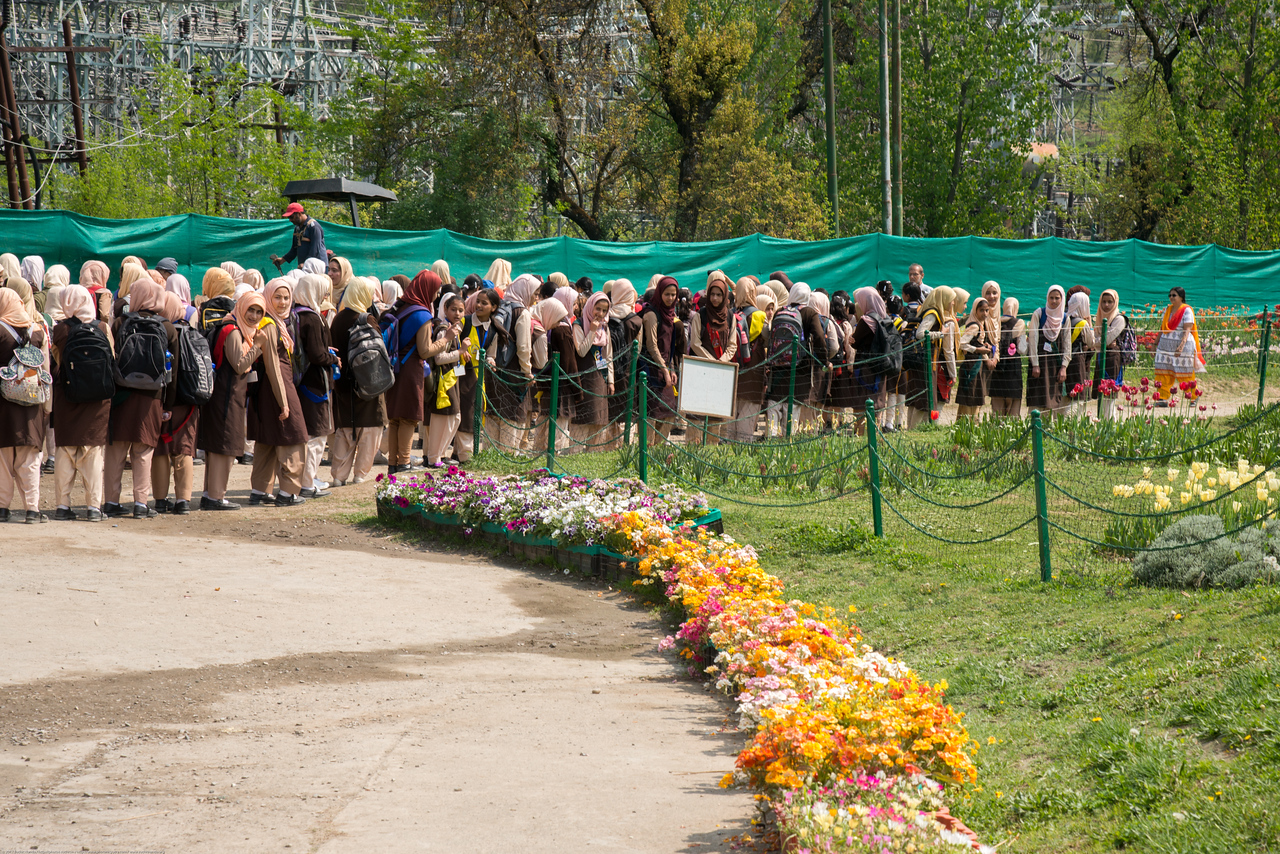 Girls in school uniform line up at the entrance to Tulip Garden, Jammu and Kashmir, India. Asia's Largest, with 20 lakh tulips of 46 varieties spread over 30 hectares in the foothills of the snow-clad Zabarwan range.