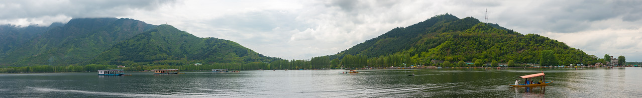 Panoramic view of Dal Lake from the floating house boats. Srinagar, Jammu and Kashmir, India.<br /> <br /> They are usually moored at the edges of the Dal Lake and Nageen lakes. Some were built in the early 1900s, and are still being rented out to tourists.