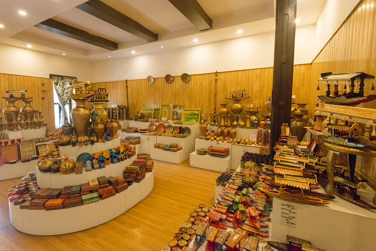 Kashmir Government Arts Emporium, Srinagar, J&K, Kashmir, India. Kashmiri crafts at fixed prices are displayed and sold in the century-old half-timbered former British Residency Building (gutted by fire in 1998, restored in 2004), set in a splendid park shaded by mature, rare trees.