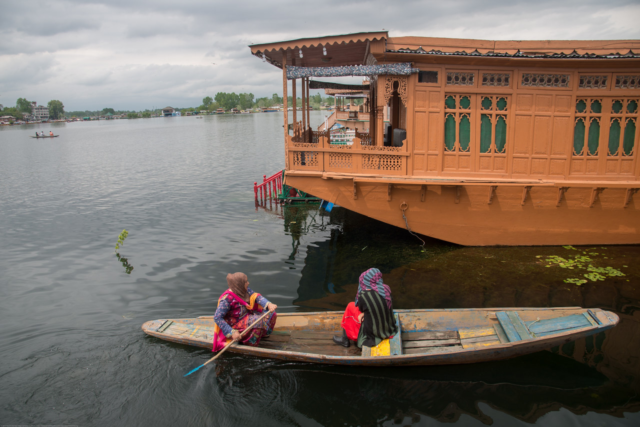 "Floating house boats on Dal Lake, Srinagar, Jammu and Kashmir, India.<br /> They are usually moored at the edges of the Dal Lake and Nageen lakes. A luxury houseboat, like a luxury hotel, has fine furniture, good carpets and modern bathroom fittings. All houseboats, regardless of category, have highly personalized service. Not only is there always a ""houseboy"" for every boat, but the owner and his family are often close by. Some overlook the main road, others look out onto lotus gardens and others face tiny local markets and villages, which are also floating on the lake."