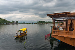 Shikaras ferry food, gifts and other items of sale to the front of the floating house boats on Dal Lake, Srinagar, Jammu and Kashmir, India. They are also the mode of transport to and from t ...