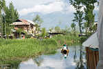 Residents use shikaras (boats) near the floating house boats on Dal Lake, Srinagar, Jammu and Kashmir, India.  House boats are usually moored at the edges of the Dal Lake and Nageen lakes. S ...