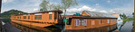 Panoramic image of the Floating house boats on Dal Lake, Srinagar, Jammu and Kashmir, India.  They are usually moored at the edges of the Dal Lake and Nageen lakes. Some were built in the ea ...