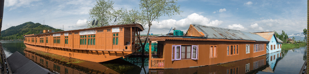 Panoramic image of the Floating house boats on Dal Lake, Srinagar, Jammu and Kashmir, India.<br /> <br /> They are usually moored at the edges of the Dal Lake and Nageen lakes. Some were built in the early 1900s, and are still being rented out to tourists.