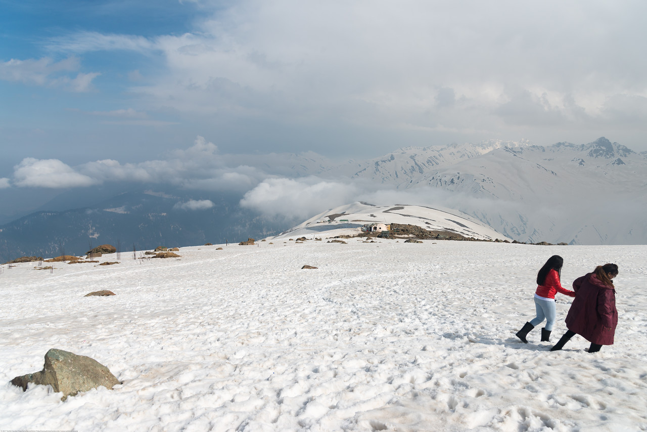 Tourists walking in the snow covered mountains at Gulmarg, Kashmir, J&K, India.