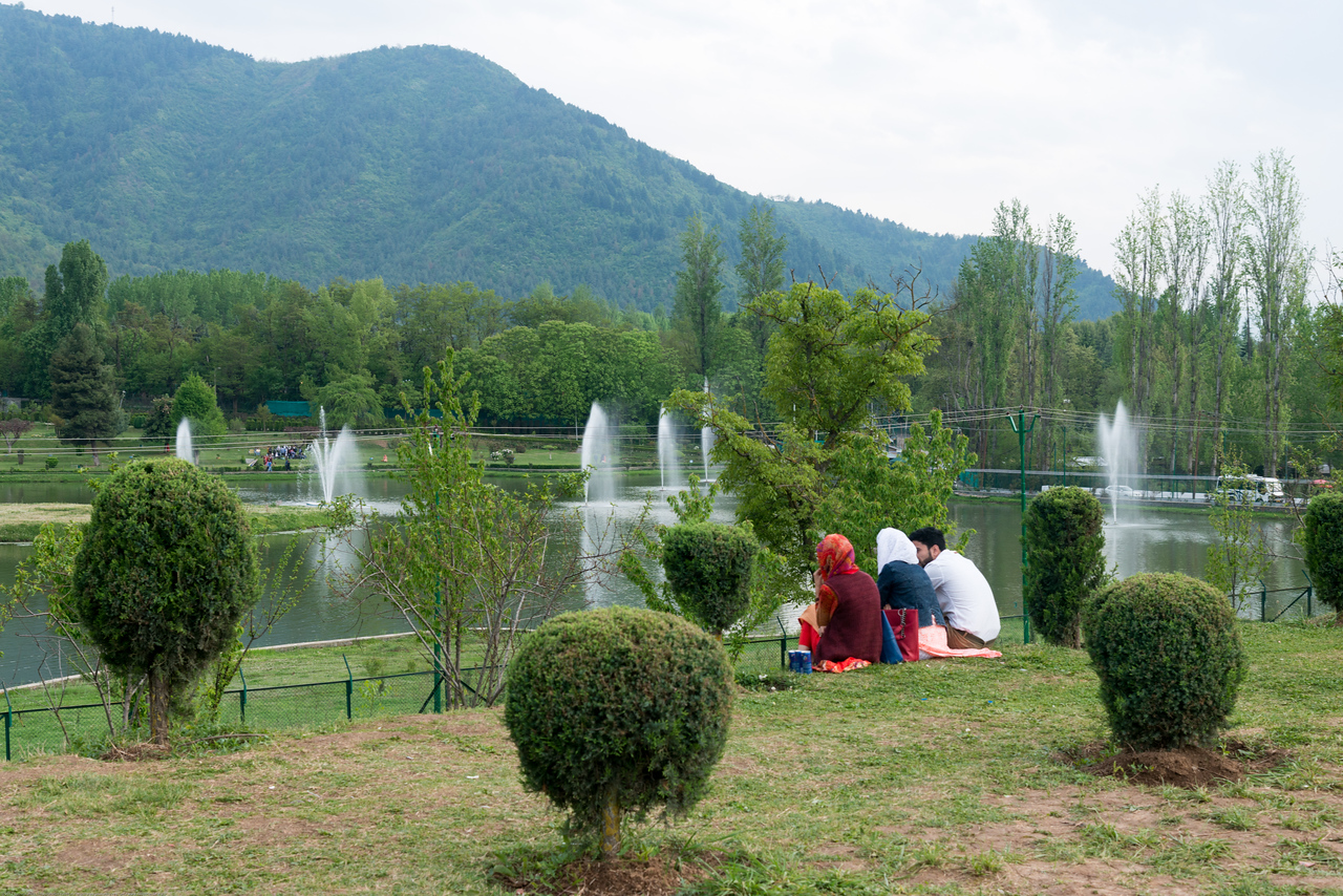 Visitors enjoy the view at the Tulip Garden, Jammu and Kashmir, India. Asia's Largest, with 20 lakh tulips of 46 varieties spread over 30 hectares in the foothills of the snow-clad Zabarwan range.
