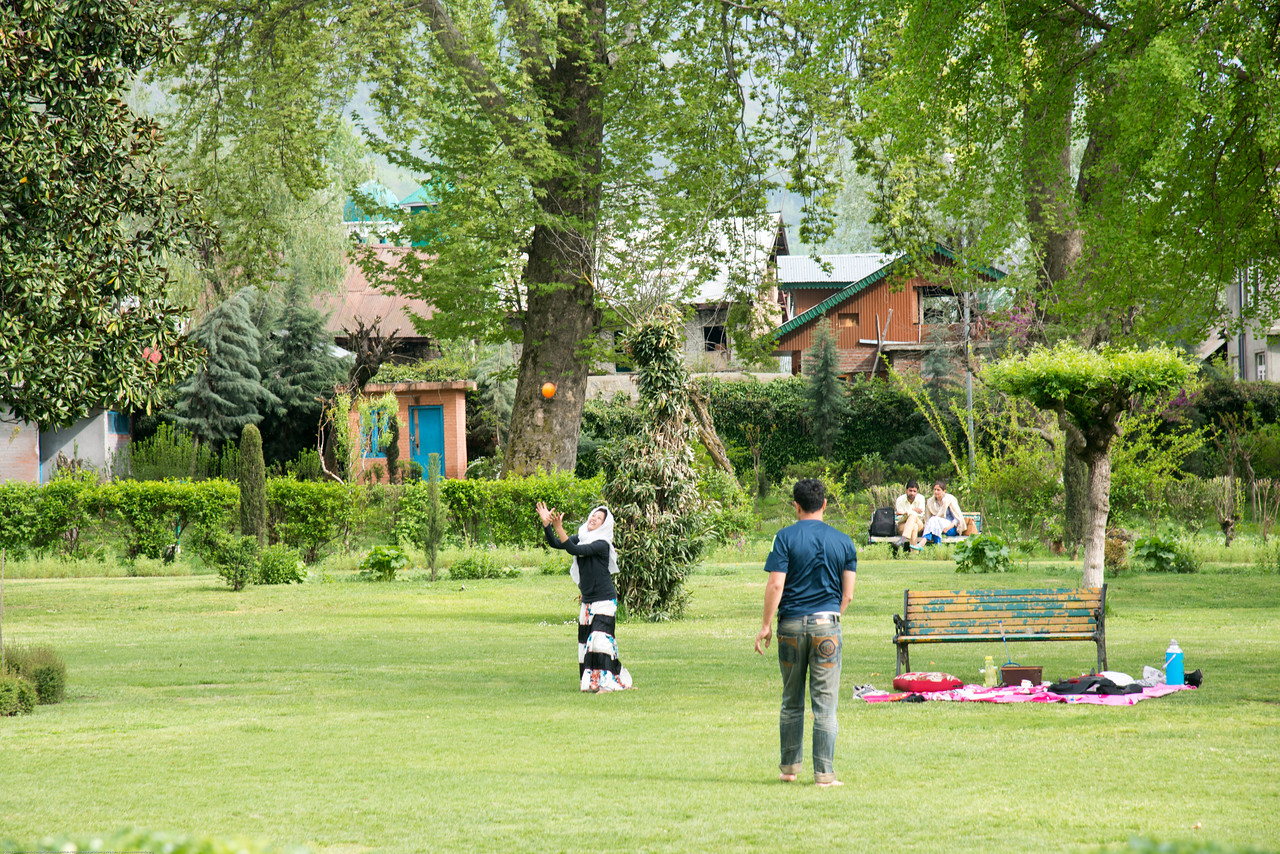 Visitors play in the park: Shalimar Bagh (Hindi: शालीमार बाग़; Urdu: شالیمار باغ) is a Mughal garden in Srinagar, Kashmir linked via a channel to Dal Lake. The public park, Shalimar Garden, was built by Mughal Emperor Jahangir for his wife Noor Jahan, in 1619.