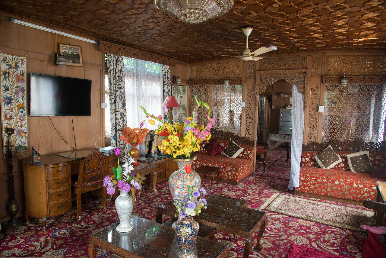 Floating house boats on Dal Lake, Srinagar, Jammu and Kashmir, India.<br /> <br /> They are usually moored at the edges of the Dal Lake and Nageen lakes. Some were built in the early 1900s, and are still being rented out to tourists. Inside view of the living room in the house boat.