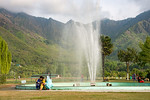 Visitors sit around the water fountains at the Tulip Garden, Jammu and Kashmir, India. Asia?s Largest, with 20 lakh tulips of 46 varieties spread over 30 hectares in the foothills of the s ...