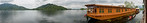 Panoramic view from the house boats on Dal Lake, Srinagar, Jammu and Kashmir, India.  They are usually moored at the edges of the Dal Lake and Nageen lakes. Some were built in the early 1900 ...