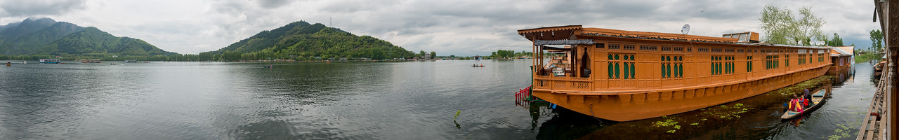 Panoramic view from the house boats on Dal Lake, Srinagar, Jammu and Kashmir, India.<br /> <br /> They are usually moored at the edges of the Dal Lake and Nageen lakes. Some were built in the early 1900s, and are still being rented out to tourists.
