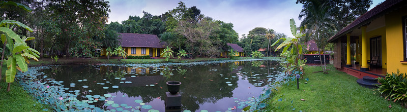 Panoramic view behind the cottage bungalow at the hotel. Vivanta by Taj - Kumarakom is a Tropical, lakefront 19th-century hotel with a lagoon , dining & an Ayurvedic spa with swiming pool. Set in a colonial-era bungalows on the shores of Kumarakom Lake, this upscale hotel is built around a central lagoon, with the lake on one side and Pathiramanal island bird sanctuary adjoining it. Located at: Kumarakom, Kavanattinkara, Kottayam, Kerala, India