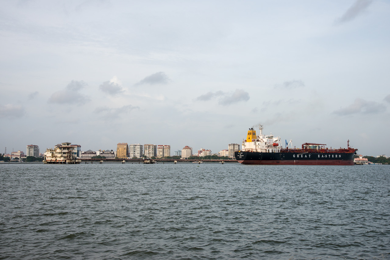 Ships seen from Embarkation Jetty, at Kochi, Kerala, India. The jetty connects to Fort Kochi as well as Marine drive. Small non descript place which is peaceful. Boat ride costs just Rs 4 yes just four and frequency is about 15 min.