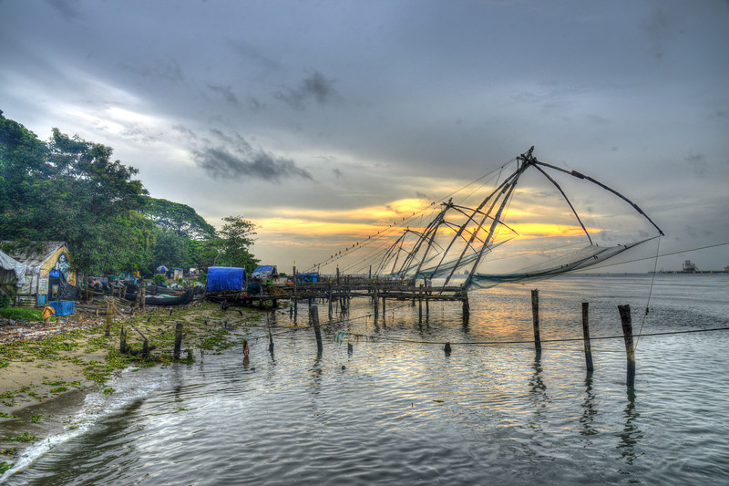 Traditional Chinese fishing nets are still in use in Kochi.<br /> Kochi earlier called Cochin, is a major port city on the west coast of India by the Arabian Sea and is part of the district of Ernakulam in the state of Kerala. Kochi is often called by the name Ernakulam, which refers to the mainland part of the city. Heralded as the Queen of the Arabian Sea, Kochi was an important spice trading centre on the Arabian Sea coast from the 14th century. Occupied by the Portuguese Empire in 1503, Kochi was the first of the European colonies in colonial India. It remained the main seat of Portuguese India until 1530, when Goa was chosen instead. The city was later occupied by the Dutch and the British, with the Kingdom of Cochin becoming a princely state.