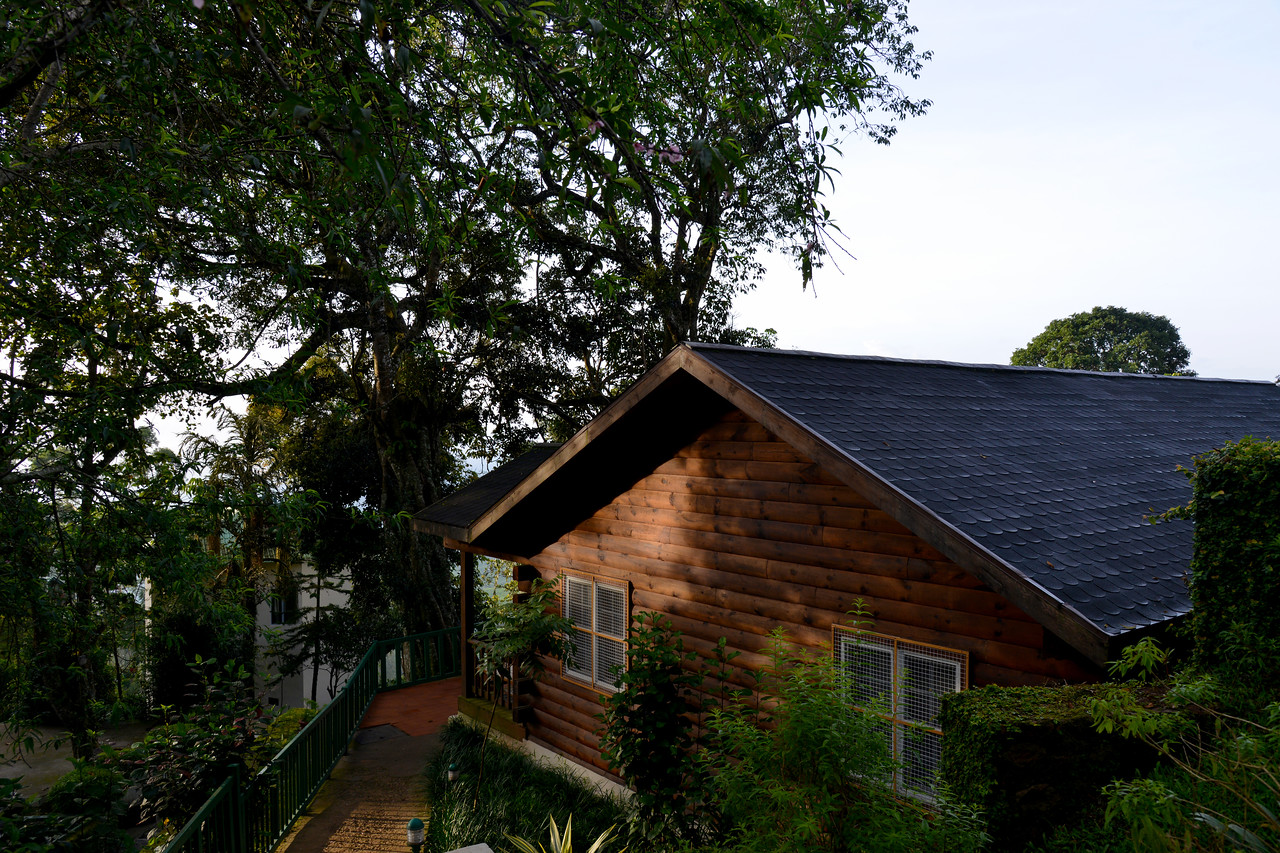 """Cottages at Munnar. Club Mahindra Munnar, Lakeview.<br /> <br /> Munnar ( മുന്നാർ ) is situated on the Kannan Devan Hills ( KDH ) Village in Devikulam taluk. Munnar is a famous hill station on the Western Ghats of India. A range of mountains situated in the Idukki district of the Indian state of Kerala. The name Munnar means """"three rivers"""", referring to the town's strategic location at the confluence of the Madhurapuzha, Nallathanni and Kundaly rivers."""