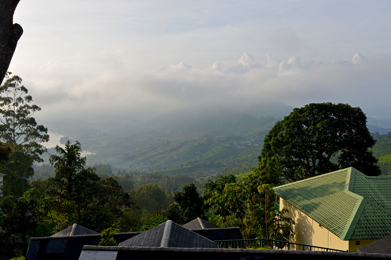 """View from Club Mahindra Munnar. Club Mahindra Munnar, Lakeview.<br /> <br /> Munnar ( മുന്നാർ ) is situated on the Kannan Devan Hills ( KDH ) Village in Devikulam taluk. Munnar is a famous hill station on the Western Ghats of India. A range of mountains situated in the Idukki district of the Indian state of Kerala. The name Munnar means """"three rivers"""", referring to the town's strategic location at the confluence of the Madhurapuzha, Nallathanni and Kundaly rivers."""