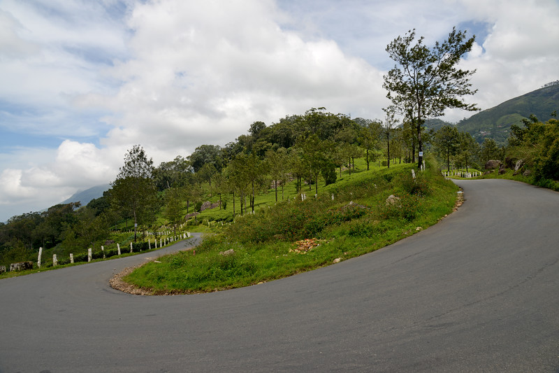 """Winding hilly roads at Munnar.<br /> Munnar ( മുന്നാർ ) is situated on the Kannan Devan Hills ( KDH ) Village in Devikulam taluk. Munnar is a famous hill station on the Western Ghats of India. A range of mountains situated in the Idukki district of the Indian state of Kerala. The name Munnar means """"three rivers"""", referring to the town's strategic location at the confluence of the Madhurapuzha, Nallathanni and Kundaly rivers."""