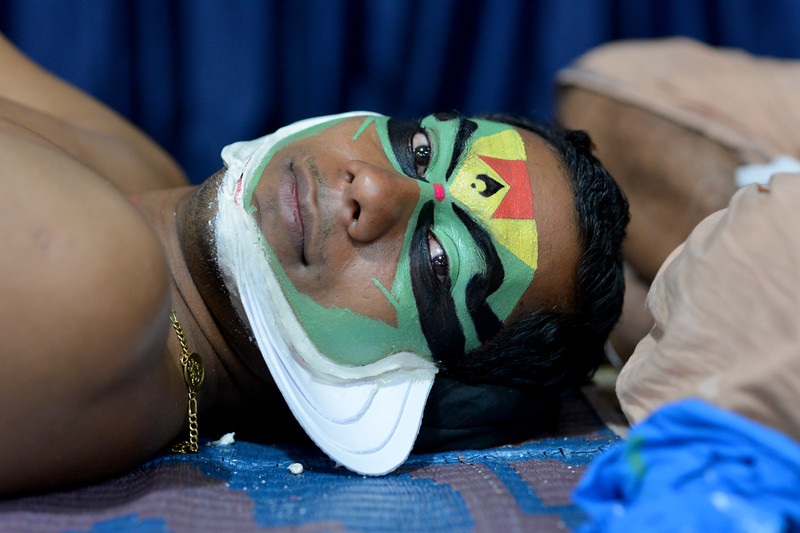 Facial make up being applied onto Lord Indra's handsome son - Jayantha. It can take anywhere from 3 to 4 hours for this.<br /> <br /> Mudra Kathakali Centre, Thekkady. Kathakali, literally meaning `story-play', is a dance-drama originated in the 17th century in Kerala, one of the smallest states in India lying on the west coast of the Indian peninsula. Kathakali is the result of a fusion between all Indian theater tradition represented by Koodiyattom and the indigenous tradition of folk dance forms. It was one of the Rajas (Chieftain) of Kottarakkara, who wrote the first play intended for Kathakali performance. They form a cycle of eight stories based on Ramayana. Stories typically deal with the Mahabharata, Ramayana and the ancient scriptures known as the Puranas. This is performed in a text which is generally Sanskritised Malayalam.<br /> <br /> Thekkady (Idukki district) in Kerala is the location of the Periyar National Park, which is an important tourist attraction in India.