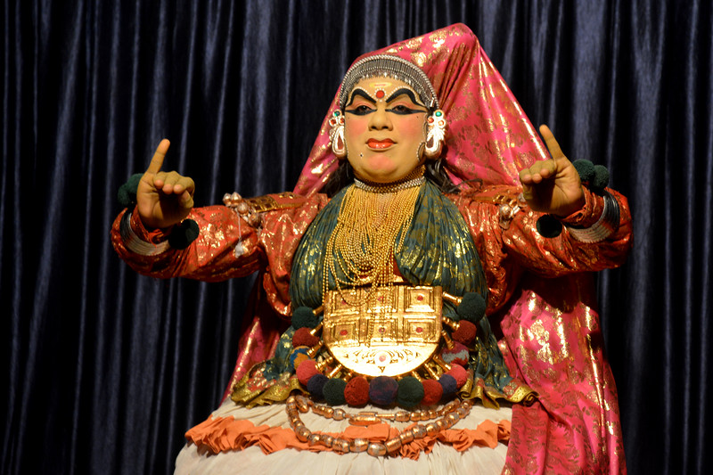 Mudra Kathakali Centre, Thekkady. Kathakali, literally meaning `story-play', is a dance-drama originated in the 17th century in Kerala, one of the smallest states in India lying on the west coast of the Indian peninsula. Kathakali is the result of a fusion between all Indian theater tradition represented by Koodiyattom and the indigenous tradition of folk dance forms. It was one of the Rajas (Chieftain) of Kottarakkara, who wrote the first play intended for Kathakali performance. They form a cycle of eight stories based on Ramayana. Stories typically deal with the Mahabharata, Ramayana and the ancient scriptures known as the Puranas. This is performed in a text which is generally Sanskritised Malayalam.<br /> <br /> Thekkady (Idukki district) in Kerala is the location of the Periyar National Park, which is an important tourist attraction in India.