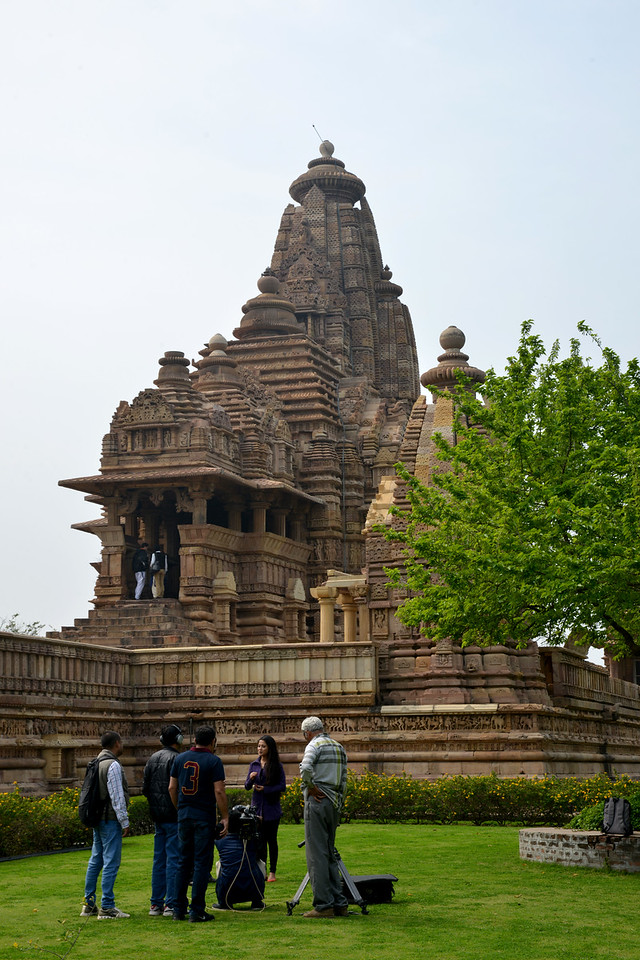 """Interview on the lawns at Khajuraho Temples.<br /> Khajuraho - Land Of The Moon God is located in the Indian state of Madhya Pradesh (MP) and roughly 620 kilometers (385 miles) southeast of New Delhi. Khajuraho was the cultural capital of the Chandela Rajputs, a Hindu dynasty that ruled from the 10th to 12th centuries. The temples of Khajuraho are famous for their so-called """"erotic sculptures"""".<br /> <br /> Symbolising a medieval legacy, the Khajuraho temples are a perfect fusion of architectural and sculptural excellence, representing one of the finest examples of Indian art. To some, they are the most graphic, erotic and sensuous sculptures the world has ever known. But Khajuraho has not received the attention it deserves for its significant contribution to the religious art of India - there are literally hundreds of exquisite images on the interior and exterior walls of the shrines.<br /> <br /> Architecturally they are unique. While each temple has a distinct plan and design, several features are common to all. They are all built on high platforms, several metres off the ground. The stone used throughout is either granite or a combination of light sandstone and granite. Each of these temples has an entrance hall or mandapa, and a sanctum sanctorum or garbha griha. The roofs of these various sections have a distinct form. The porch and hall have pyramidal roofs made of several horizontal layers. The inner sanctum's roof is a conical tower - a colossal pile of stone (often 30m high) made of an arrangement of miniature towers called shikharas."""