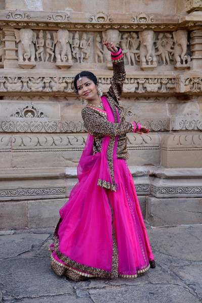"Kathak dancer Smt Samiksha Sharma at the Khajuraho Temple. <br /> Khajuraho - Land Of The Moon God is located in the Indian state of Madhya Pradesh (MP) and roughly 620 kilometers (385 miles) southeast of New Delhi. Khajuraho was the cultural capital of the Chandela Rajputs, a Hindu dynasty that ruled from the 10th to 12th centuries. The temples of Khajuraho are famous for their so-called ""erotic sculptures"".<br /> <br /> Symbolising a medieval legacy, the Khajuraho temples are a perfect fusion of architectural and sculptural excellence, representing one of the finest examples of Indian art. To some, they are the most graphic, erotic and sensuous sculptures the world has ever known. But Khajuraho has not received the attention it deserves for its significant contribution to the religious art of India - there are literally hundreds of exquisite images on the interior and exterior walls of the shrines.<br /> <br /> Architecturally they are unique. While each temple has a distinct plan and design, several features are common to all. They are all built on high platforms, several metres off the ground. The stone used throughout is either granite or a combination of light sandstone and granite. Each of these temples has an entrance hall or mandapa, and a sanctum sanctorum or garbha griha. The roofs of these various sections have a distinct form. The porch and hall have pyramidal roofs made of several horizontal layers. The inner sanctum's roof is a conical tower - a colossal pile of stone (often 30m high) made of an arrangement of miniature towers called shikharas."