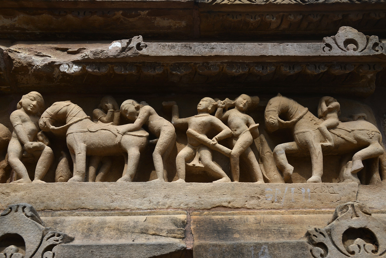 "Erotic and sexual acts depicted in stone carvings at Khajuraho. Khajuraho - Land Of The Moon God is located in the Indian state of Madhya Pradesh (MP) and roughly 620 kilometers (385 miles) southeast of New Delhi. Khajuraho was the cultural capital of the Chandela Rajputs, a Hindu dynasty that ruled from the 10th to 12th centuries. The temples of Khajuraho are famous for their so-called ""erotic sculptures"".<br /> <br /> Symbolising a medieval legacy, the Khajuraho temples are a perfect fusion of architectural and sculptural excellence, representing one of the finest examples of Indian art. To some, they are the most graphic, erotic and sensuous sculptures the world has ever known. But Khajuraho has not received the attention it deserves for its significant contribution to the religious art of India - there are literally hundreds of exquisite images on the interior and exterior walls of the shrines.<br /> <br /> Architecturally they are unique. While each temple has a distinct plan and design, several features are common to all. They are all built on high platforms, several metres off the ground. The stone used throughout is either granite or a combination of light sandstone and granite. Each of these temples has an entrance hall or mandapa, and a sanctum sanctorum or garbha griha. The roofs of these various sections have a distinct form. The porch and hall have pyramidal roofs made of several horizontal layers. The inner sanctum's roof is a conical tower - a colossal pile of stone (often 30m high) made of an arrangement of miniature towers called shikharas."