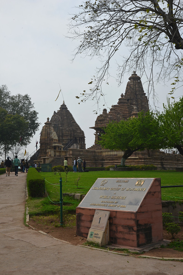 """Khajuraho Group of Monuments, an UNESCO World Heritage maintained by Archaeological Survey of India (ASI).<br /> Khajuraho - Land Of The Moon God is located in the Indian state of Madhya Pradesh (MP) and roughly 620 kilometers (385 miles) southeast of New Delhi. Khajuraho was the cultural capital of the Chandela Rajputs, a Hindu dynasty that ruled from the 10th to 12th centuries. The temples of Khajuraho are famous for their so-called """"erotic sculptures"""".<br /> <br /> Symbolising a medieval legacy, the Khajuraho temples are a perfect fusion of architectural and sculptural excellence, representing one of the finest examples of Indian art. To some, they are the most graphic, erotic and sensuous sculptures the world has ever known. But Khajuraho has not received the attention it deserves for its significant contribution to the religious art of India - there are literally hundreds of exquisite images on the interior and exterior walls of the shrines.<br /> <br /> Architecturally they are unique. While each temple has a distinct plan and design, several features are common to all. They are all built on high platforms, several metres off the ground. The stone used throughout is either granite or a combination of light sandstone and granite. Each of these temples has an entrance hall or mandapa, and a sanctum sanctorum or garbha griha. The roofs of these various sections have a distinct form. The porch and hall have pyramidal roofs made of several horizontal layers. The inner sanctum's roof is a conical tower - a colossal pile of stone (often 30m high) made of an arrangement of miniature towers called shikharas."""