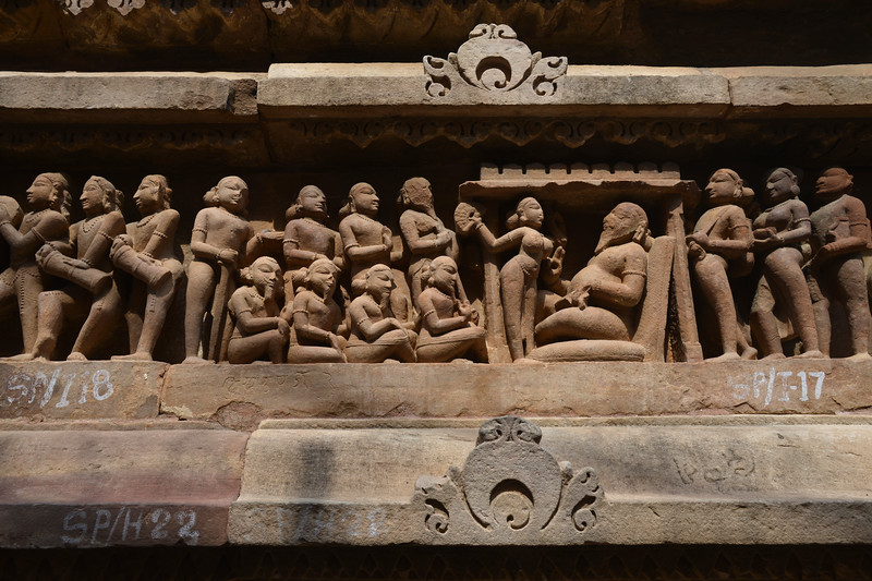 """Erotic and sexual acts depicted in stone carvings at Khajuraho. Khajuraho - Land Of The Moon God is located in the Indian state of Madhya Pradesh (MP) and roughly 620 kilometers (385 miles) southeast of New Delhi. Khajuraho was the cultural capital of the Chandela Rajputs, a Hindu dynasty that ruled from the 10th to 12th centuries. The temples of Khajuraho are famous for their so-called """"erotic sculptures"""".<br /> <br /> Symbolising a medieval legacy, the Khajuraho temples are a perfect fusion of architectural and sculptural excellence, representing one of the finest examples of Indian art. To some, they are the most graphic, erotic and sensuous sculptures the world has ever known. But Khajuraho has not received the attention it deserves for its significant contribution to the religious art of India - there are literally hundreds of exquisite images on the interior and exterior walls of the shrines.<br /> <br /> Architecturally they are unique. While each temple has a distinct plan and design, several features are common to all. They are all built on high platforms, several metres off the ground. The stone used throughout is either granite or a combination of light sandstone and granite. Each of these temples has an entrance hall or mandapa, and a sanctum sanctorum or garbha griha. The roofs of these various sections have a distinct form. The porch and hall have pyramidal roofs made of several horizontal layers. The inner sanctum's roof is a conical tower - a colossal pile of stone (often 30m high) made of an arrangement of miniature towers called shikharas."""