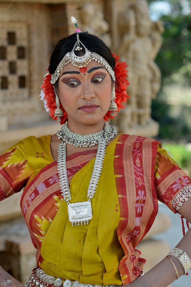 "Odissi dancer Bithika Mistry displaying various mudras at the Khajuraho Temple.<br /> <br /> <br /> Khajuraho - Land Of The Moon God is located in the Indian state of Madhya Pradesh (MP) and roughly 620 kilometers (385 miles) southeast of New Delhi. Khajuraho was the cultural capital of the Chandela Rajputs, a Hindu dynasty that ruled from the 10th to 12th centuries. The temples of Khajuraho are famous for their so-called ""erotic sculptures"".<br /> <br /> Symbolising a medieval legacy, the Khajuraho temples are a perfect fusion of architectural and sculptural excellence, representing one of the finest examples of Indian art. To some, they are the most graphic, erotic and sensuous sculptures the world has ever known. But Khajuraho has not received the attention it deserves for its significant contribution to the religious art of India - there are literally hundreds of exquisite images on the interior and exterior walls of the shrines.<br /> <br /> Architecturally they are unique. While each temple has a distinct plan and design, several features are common to all. They are all built on high platforms, several metres off the ground. The stone used throughout is either granite or a combination of light sandstone and granite. Each of these temples has an entrance hall or mandapa, and a sanctum sanctorum or garbha griha. The roofs of these various sections have a distinct form. The porch and hall have pyramidal roofs made of several horizontal layers. The inner sanctum's roof is a conical tower - a colossal pile of stone (often 30m high) made of an arrangement of miniature towers called shikharas."