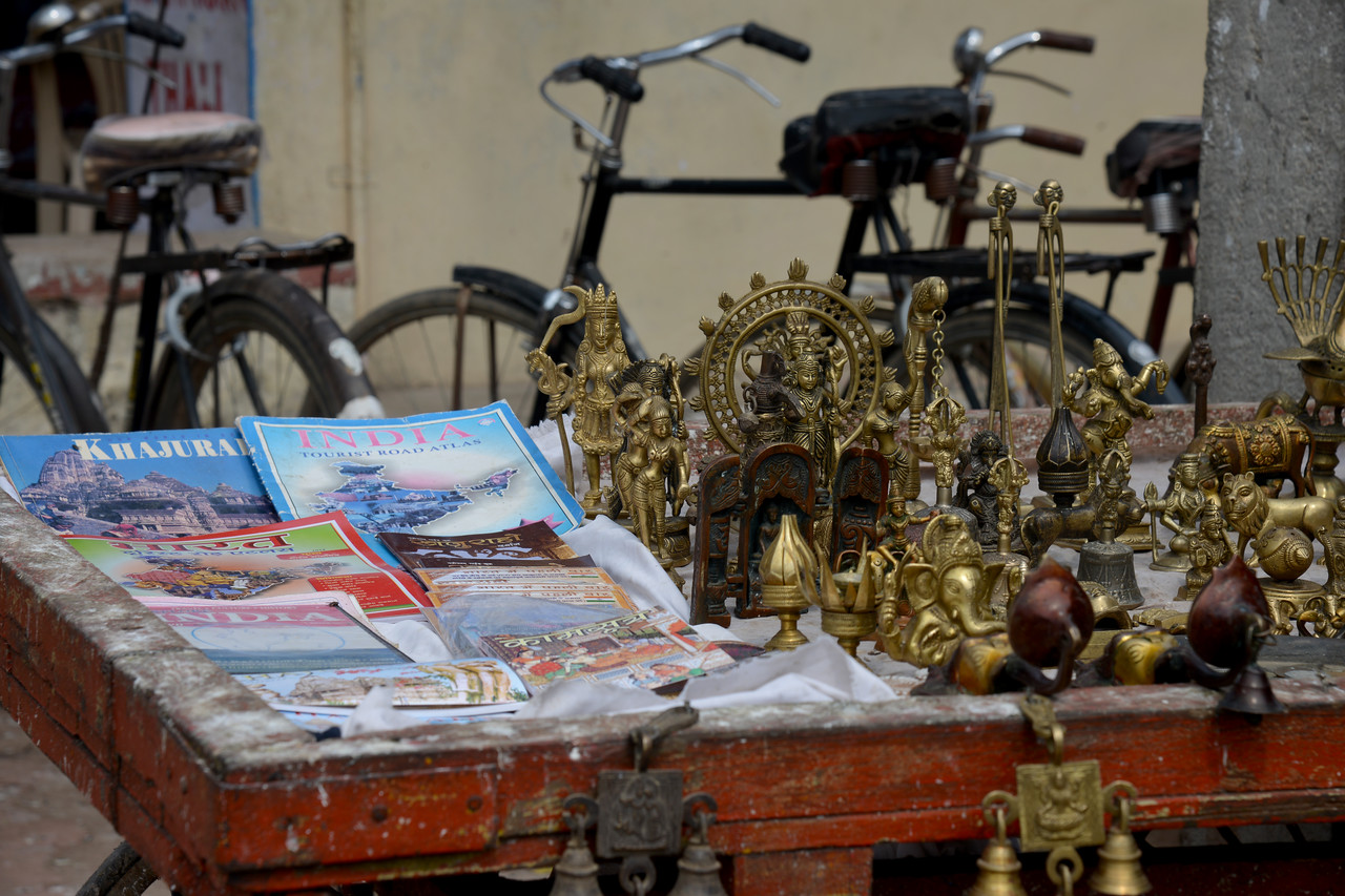 Items on sale  at Khajuraho. Khajuraho - Land Of The Moon God is located in the Indian state of Madhya Pradesh (MP) and roughly 620 kilometers (385 miles) southeast of New Delhi. Khajuraho was the cultural capital of the Chandela Rajputs, a Hindu dynasty that ruled from the 10th to 12th centuries.
