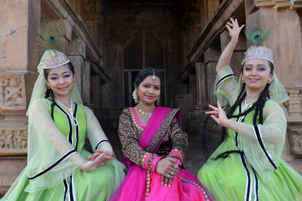 "Kathak & Uzbek dancers at the Khajuraho Temple. <br /> Khajuraho - Land Of The Moon God is located in the Indian state of Madhya Pradesh (MP) and roughly 620 kilometers (385 miles) southeast of New Delhi. Khajuraho was the cultural capital of the Chandela Rajputs, a Hindu dynasty that ruled from the 10th to 12th centuries. The temples of Khajuraho are famous for their so-called ""erotic sculptures"".<br /> <br /> Symbolising a medieval legacy, the Khajuraho temples are a perfect fusion of architectural and sculptural excellence, representing one of the finest examples of Indian art. To some, they are the most graphic, erotic and sensuous sculptures the world has ever known. But Khajuraho has not received the attention it deserves for its significant contribution to the religious art of India - there are literally hundreds of exquisite images on the interior and exterior walls of the shrines.<br /> <br /> Architecturally they are unique. While each temple has a distinct plan and design, several features are common to all. They are all built on high platforms, several metres off the ground. The stone used throughout is either granite or a combination of light sandstone and granite. Each of these temples has an entrance hall or mandapa, and a sanctum sanctorum or garbha griha. The roofs of these various sections have a distinct form. The porch and hall have pyramidal roofs made of several horizontal layers. The inner sanctum's roof is a conical tower - a colossal pile of stone (often 30m high) made of an arrangement of miniature towers called shikharas."