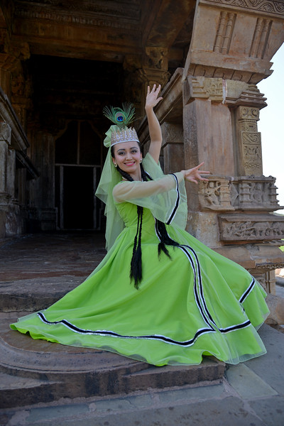 """Uzbek dancer at the Khajuraho Temple. <br /> Khajuraho - Land Of The Moon God is located in the Indian state of Madhya Pradesh (MP) and roughly 620 kilometers (385 miles) southeast of New Delhi. Khajuraho was the cultural capital of the Chandela Rajputs, a Hindu dynasty that ruled from the 10th to 12th centuries. The temples of Khajuraho are famous for their so-called """"erotic sculptures"""".<br /> <br /> Symbolising a medieval legacy, the Khajuraho temples are a perfect fusion of architectural and sculptural excellence, representing one of the finest examples of Indian art. To some, they are the most graphic, erotic and sensuous sculptures the world has ever known. But Khajuraho has not received the attention it deserves for its significant contribution to the religious art of India - there are literally hundreds of exquisite images on the interior and exterior walls of the shrines.<br /> <br /> Architecturally they are unique. While each temple has a distinct plan and design, several features are common to all. They are all built on high platforms, several metres off the ground. The stone used throughout is either granite or a combination of light sandstone and granite. Each of these temples has an entrance hall or mandapa, and a sanctum sanctorum or garbha griha. The roofs of these various sections have a distinct form. The porch and hall have pyramidal roofs made of several horizontal layers. The inner sanctum's roof is a conical tower - a colossal pile of stone (often 30m high) made of an arrangement of miniature towers called shikharas."""
