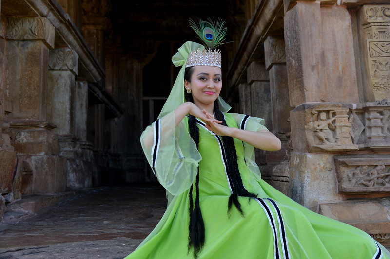 "Uzbek dancer at the Khajuraho Temple. <br /> Khajuraho - Land Of The Moon God is located in the Indian state of Madhya Pradesh (MP) and roughly 620 kilometers (385 miles) southeast of New Delhi. Khajuraho was the cultural capital of the Chandela Rajputs, a Hindu dynasty that ruled from the 10th to 12th centuries. The temples of Khajuraho are famous for their so-called ""erotic sculptures"".<br /> <br /> Symbolising a medieval legacy, the Khajuraho temples are a perfect fusion of architectural and sculptural excellence, representing one of the finest examples of Indian art. To some, they are the most graphic, erotic and sensuous sculptures the world has ever known. But Khajuraho has not received the attention it deserves for its significant contribution to the religious art of India - there are literally hundreds of exquisite images on the interior and exterior walls of the shrines.<br /> <br /> Architecturally they are unique. While each temple has a distinct plan and design, several features are common to all. They are all built on high platforms, several metres off the ground. The stone used throughout is either granite or a combination of light sandstone and granite. Each of these temples has an entrance hall or mandapa, and a sanctum sanctorum or garbha griha. The roofs of these various sections have a distinct form. The porch and hall have pyramidal roofs made of several horizontal layers. The inner sanctum's roof is a conical tower - a colossal pile of stone (often 30m high) made of an arrangement of miniature towers called shikharas."