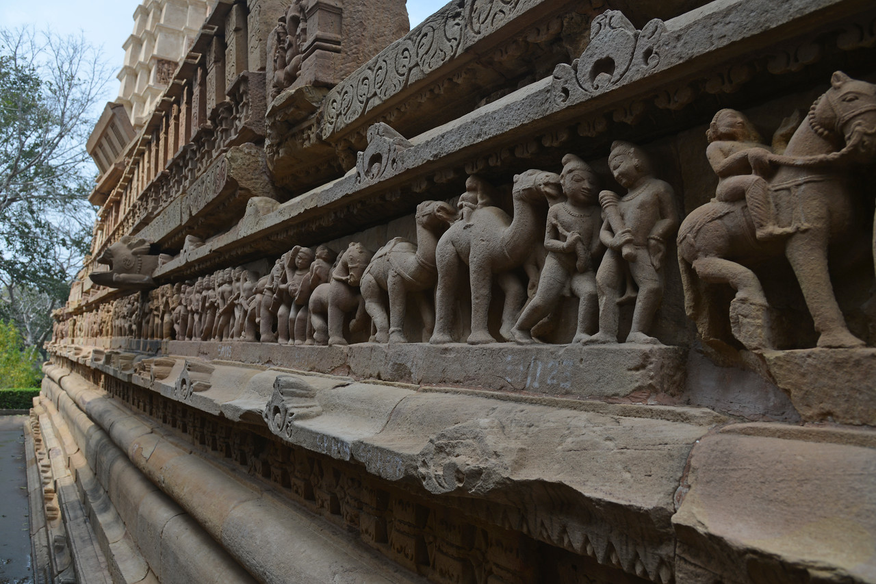 """Khajuraho Temples depict some erotic and sexual acts in stone carvings. Khajuraho - Land Of The Moon God is located in the Indian state of Madhya Pradesh (MP) and roughly 620 kilometers (385 miles) southeast of New Delhi. Khajuraho was the cultural capital of the Chandela Rajputs, a Hindu dynasty that ruled from the 10th to 12th centuries. The temples of Khajuraho are famous for their so-called """"erotic sculptures"""".<br /> <br /> Symbolising a medieval legacy, the Khajuraho temples are a perfect fusion of architectural and sculptural excellence, representing one of the finest examples of Indian art. To some, they are the most graphic, erotic and sensuous sculptures the world has ever known. But Khajuraho has not received the attention it deserves for its significant contribution to the religious art of India - there are literally hundreds of exquisite images on the interior and exterior walls of the shrines.<br /> <br /> Architecturally they are unique. While each temple has a distinct plan and design, several features are common to all. They are all built on high platforms, several metres off the ground. The stone used throughout is either granite or a combination of light sandstone and granite. Each of these temples has an entrance hall or mandapa, and a sanctum sanctorum or garbha griha. The roofs of these various sections have a distinct form. The porch and hall have pyramidal roofs made of several horizontal layers. The inner sanctum's roof is a conical tower - a colossal pile of stone (often 30m high) made of an arrangement of miniature towers called shikharas."""