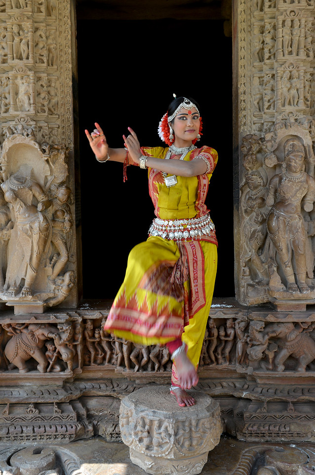 "Odissi dancer Bithika Mistry at the Khajuraho Temple.<br /> <br /> <br /> Khajuraho - Land Of The Moon God is located in the Indian state of Madhya Pradesh (MP) and roughly 620 kilometers (385 miles) southeast of New Delhi. Khajuraho was the cultural capital of the Chandela Rajputs, a Hindu dynasty that ruled from the 10th to 12th centuries. The temples of Khajuraho are famous for their so-called ""erotic sculptures"".<br /> <br /> Symbolising a medieval legacy, the Khajuraho temples are a perfect fusion of architectural and sculptural excellence, representing one of the finest examples of Indian art. To some, they are the most graphic, erotic and sensuous sculptures the world has ever known. But Khajuraho has not received the attention it deserves for its significant contribution to the religious art of India - there are literally hundreds of exquisite images on the interior and exterior walls of the shrines.<br /> <br /> Architecturally they are unique. While each temple has a distinct plan and design, several features are common to all. They are all built on high platforms, several metres off the ground. The stone used throughout is either granite or a combination of light sandstone and granite. Each of these temples has an entrance hall or mandapa, and a sanctum sanctorum or garbha griha. The roofs of these various sections have a distinct form. The porch and hall have pyramidal roofs made of several horizontal layers. The inner sanctum's roof is a conical tower - a colossal pile of stone (often 30m high) made of an arrangement of miniature towers called shikharas."