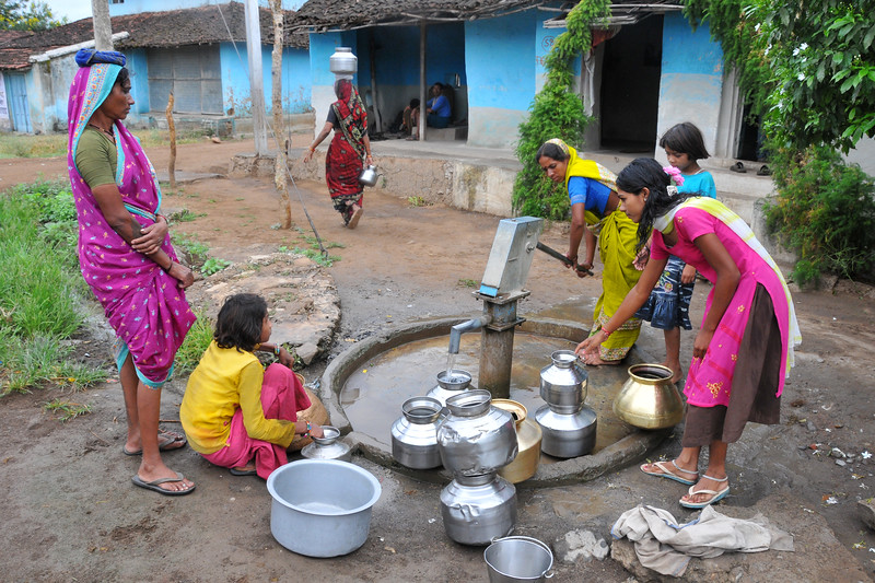Women filling water in a village.<br /> Villages in rural India in the state of Maharashtra.