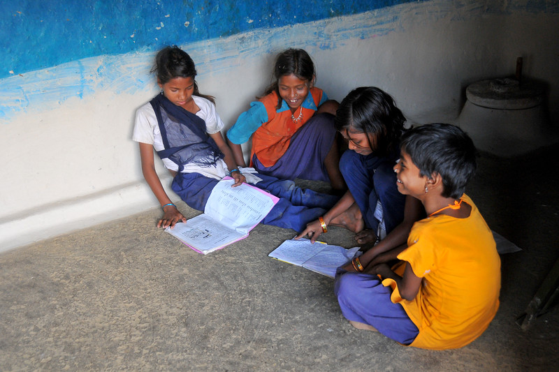 Young girls in a village in rural India in the state of Maharashtra studying together.