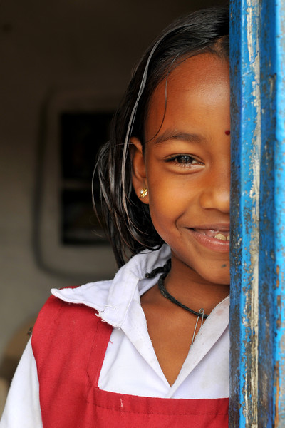 Portrait of a shy young girl in her village.<br /> Villages in rural India in the state of Maharashtra.