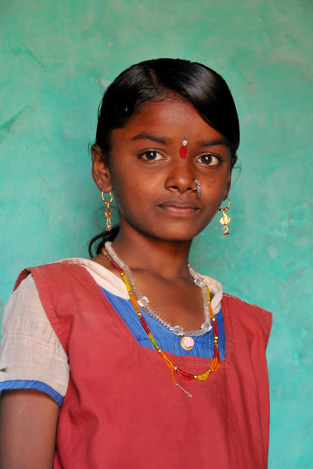 Young girl in her school uniform at her village.<br /> Villages in rural India in the state of Maharashtra.