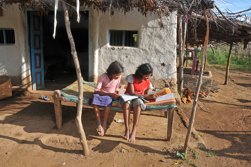 Girls study in their village home.<br /> Villages in rural India in the state of Maharashtra.