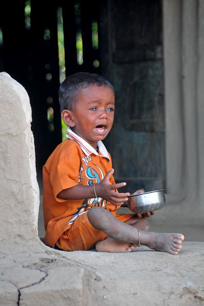 A little child crying at a village in rural India in the state of Maharashtra.