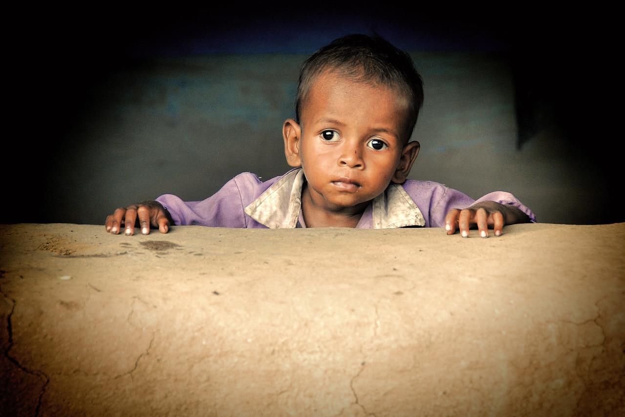 Young boy in a village in rural India in the state of Maharashtra.