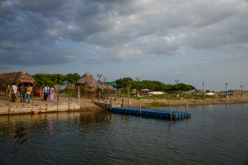 Boat jetty at Paradise Beach, Puducherry, South India. Small strip of beach reachable by boat. The beach is serene but people out to make a quick buck and there is no infrastructure. Needs serious improvement. Chunnambar river opens to the Bay of Bengal here.