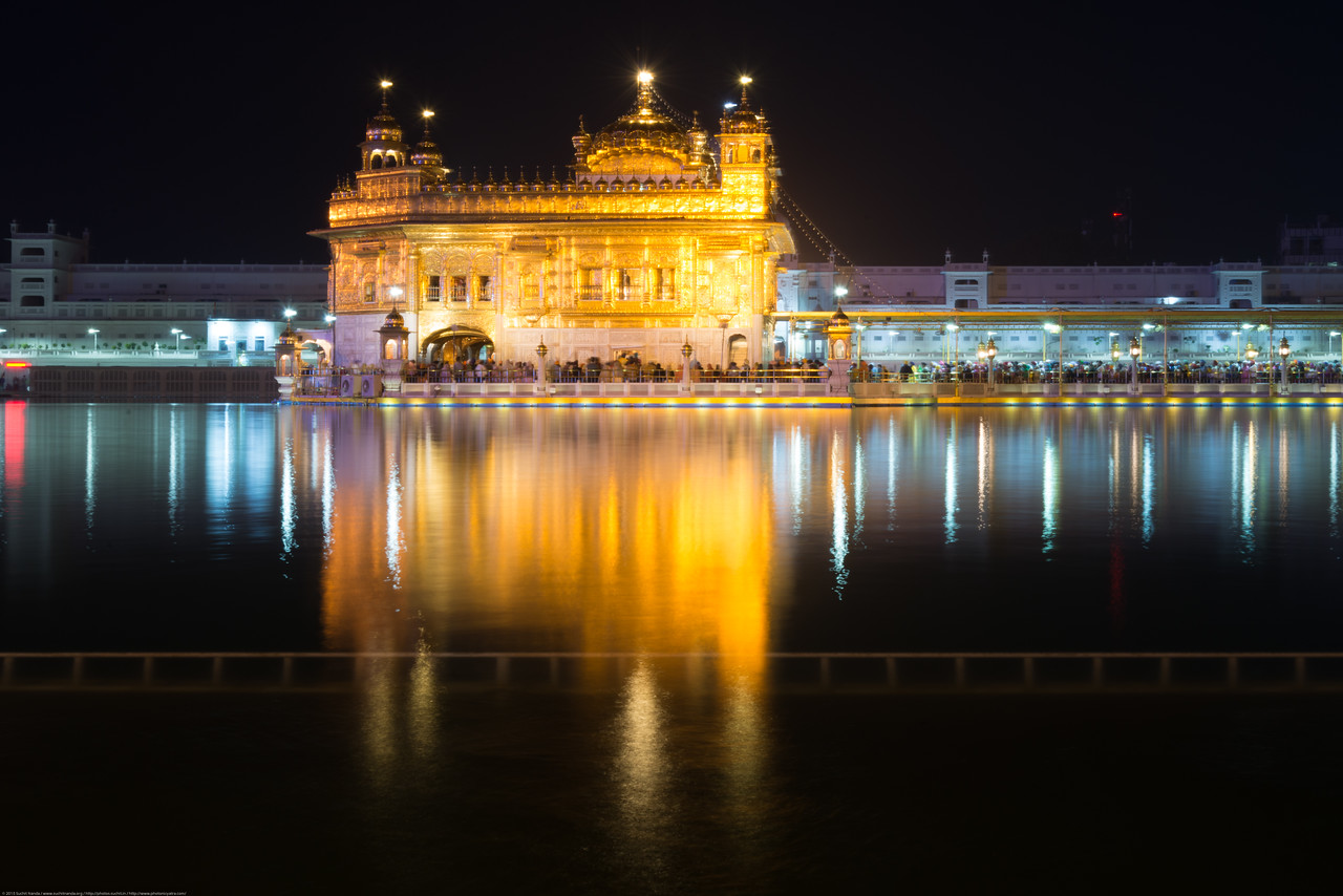 """Glittering Golden Temple. The Harmandir Sahib (Punjabi: ਹਰਿਮੰਦਰ ਸਾਹਿਬ), also Darbar Sahib (Punjabi: ਦਰਬਾਰ ਸਾਹਿਬ, )(The abode of God), and informally called the """"Golden Temple"""", is the holiest Sikh gurdwara located in the city of Amritsar, Punjab, North India."""