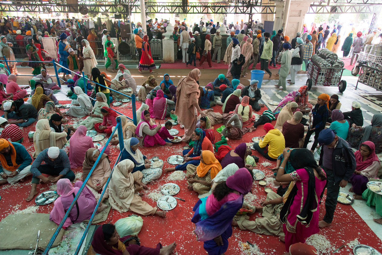 """Vast quantities of food is cooked and offered free every day at The Harmandir Sahib (Punjabi: ਹਰਿਮੰਦਰ ਸਾਹਿਬ), also Darbar Sahib (Punjabi: ਦਰਬਾਰ ਸਾਹਿਬ, )(The abode of God), and informally called the """"Golden Temple"""", is the holiest Sikh gurdwara located in the city of Amritsar, Punjab, North India."""