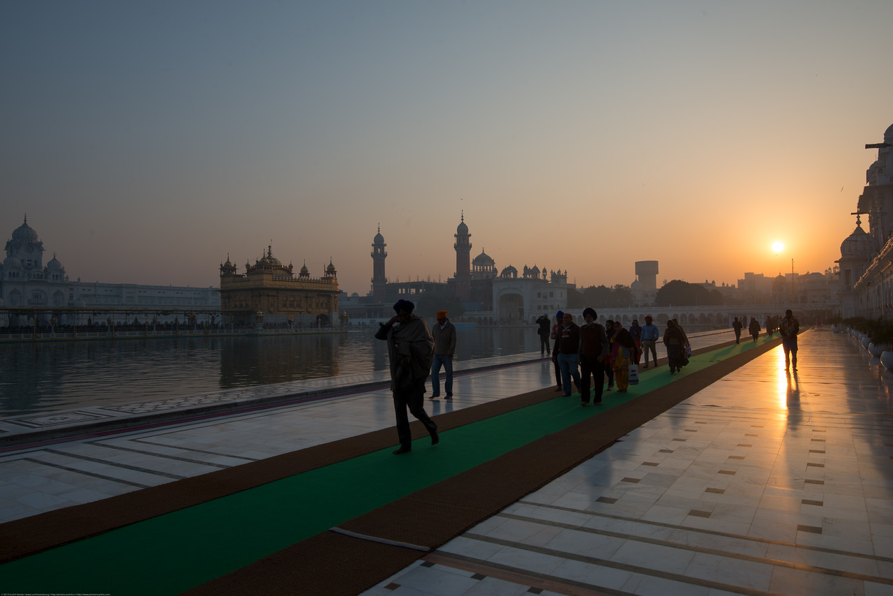 """Sunrise at The Harmandir Sahib (Punjabi: ਹਰਿਮੰਦਰ ਸਾਹਿਬ), also Darbar Sahib (Punjabi: ਦਰਬਾਰ ਸਾਹਿਬ, )(The abode of God), and informally called the """"Golden Temple"""", is the holiest Sikh gurdwara located in the city of Amritsar, Punjab, North India."""