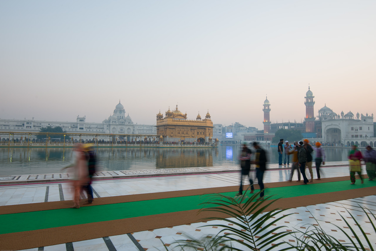 "Many come in the morning to pray and serve at The Harmandir Sahib (Punjabi: ਹਰਿਮੰਦਰ ਸਾਹਿਬ), also Darbar Sahib (Punjabi: ਦਰਬਾਰ ਸਾਹਿਬ, )(The abode of God), and informally called the ""Golden Temple"", is the holiest Sikh gurdwara located in the city of Amritsar, Punjab, North India."