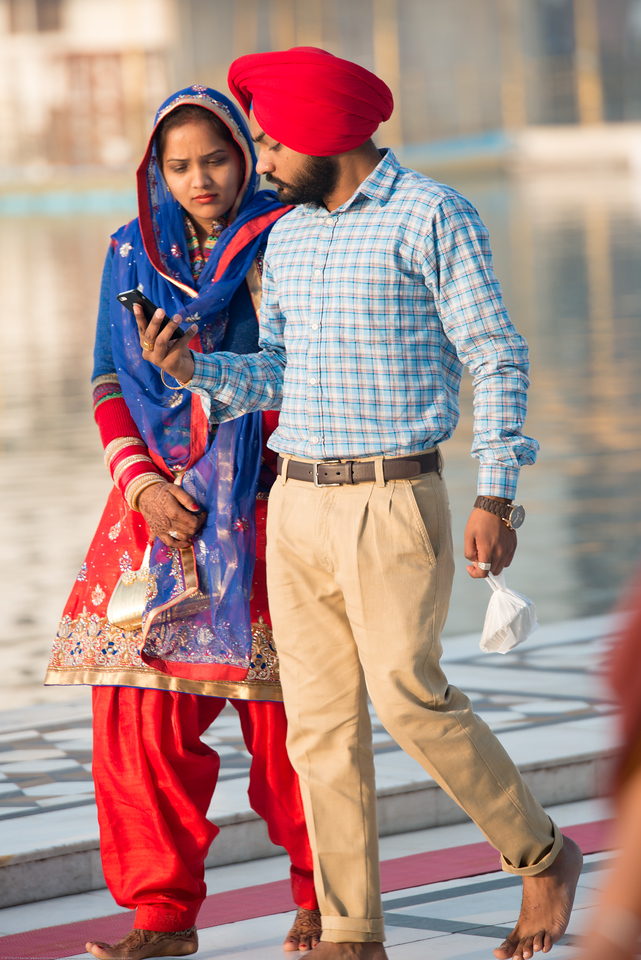 """Newly married couples come for blessings to The Harmandir Sahib (Punjabi: ਹਰਿਮੰਦਰ ਸਾਹਿਬ), also Darbar Sahib (Punjabi: ਦਰਬਾਰ ਸਾਹਿਬ, )(The abode of God), and informally called the """"Golden Temple"""", is the holiest Sikh gurdwara located in the city of Amritsar, Punjab, North India."""