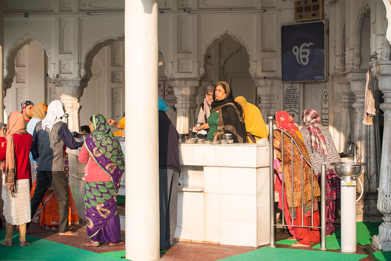 "Women doing service at The Harmandir Sahib (Punjabi: ਹਰਿਮੰਦਰ ਸਾਹਿਬ), also Darbar Sahib (Punjabi: ਦਰਬਾਰ ਸਾਹਿਬ, )(The abode of God), and informally called the ""Golden Temple"", is the holiest Sikh gurdwara located in the city of Amritsar, Punjab, North India."