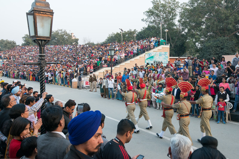 Indian flag being carried at the Indo-Pak border. Attari/Wagah (Punjabi (Gurmukhi): ਵਾਹਗਾ, Hindi: वाघा, Urdu: واہگہ‎) border lies on the Grand Trunk Road between the cities of Amritsar, Punjab, India, and Lahore, Punjab, Pakistan.